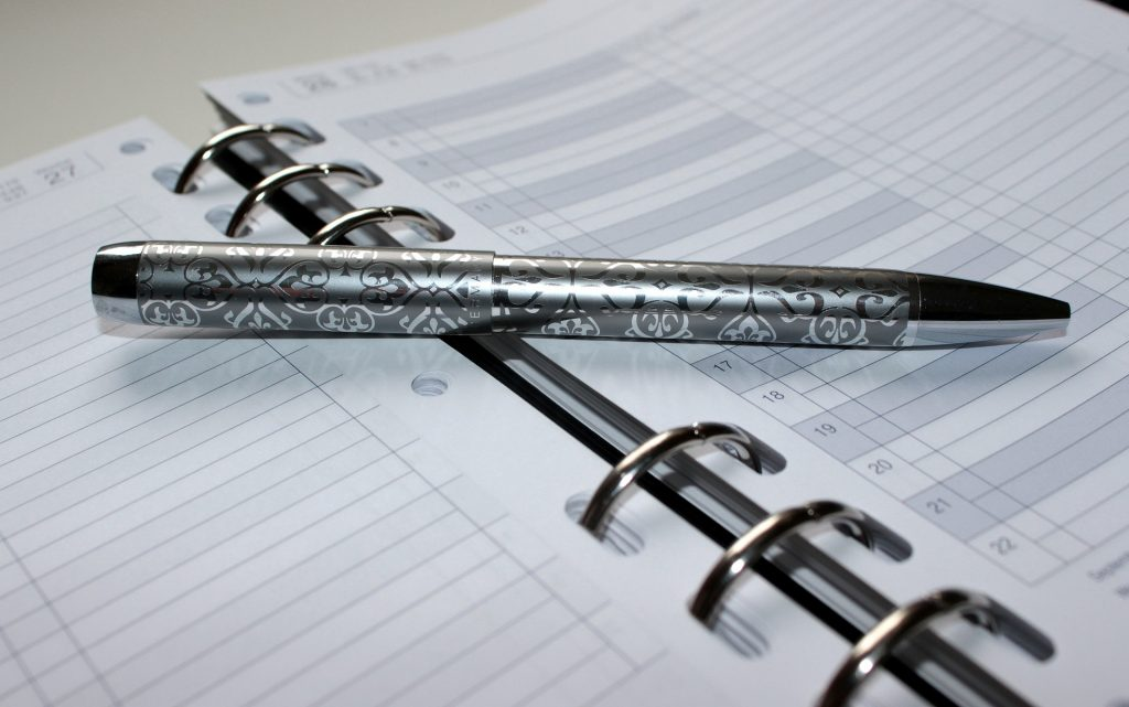 This is a photo of a pen on an appointment book