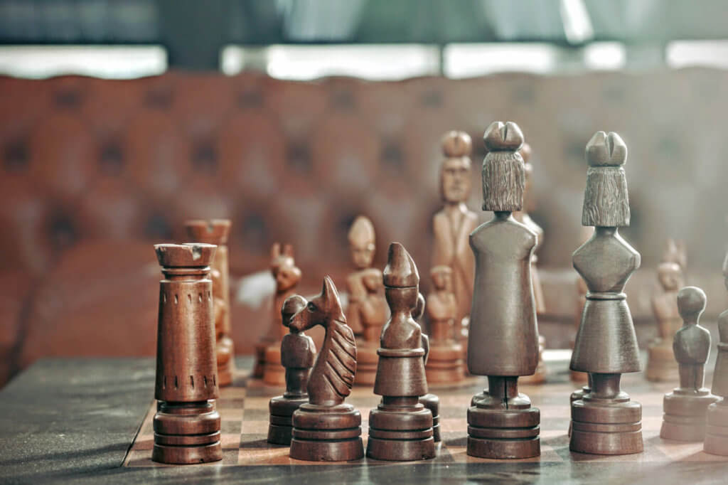 Photo of chess game to show how to build your website with a game plan