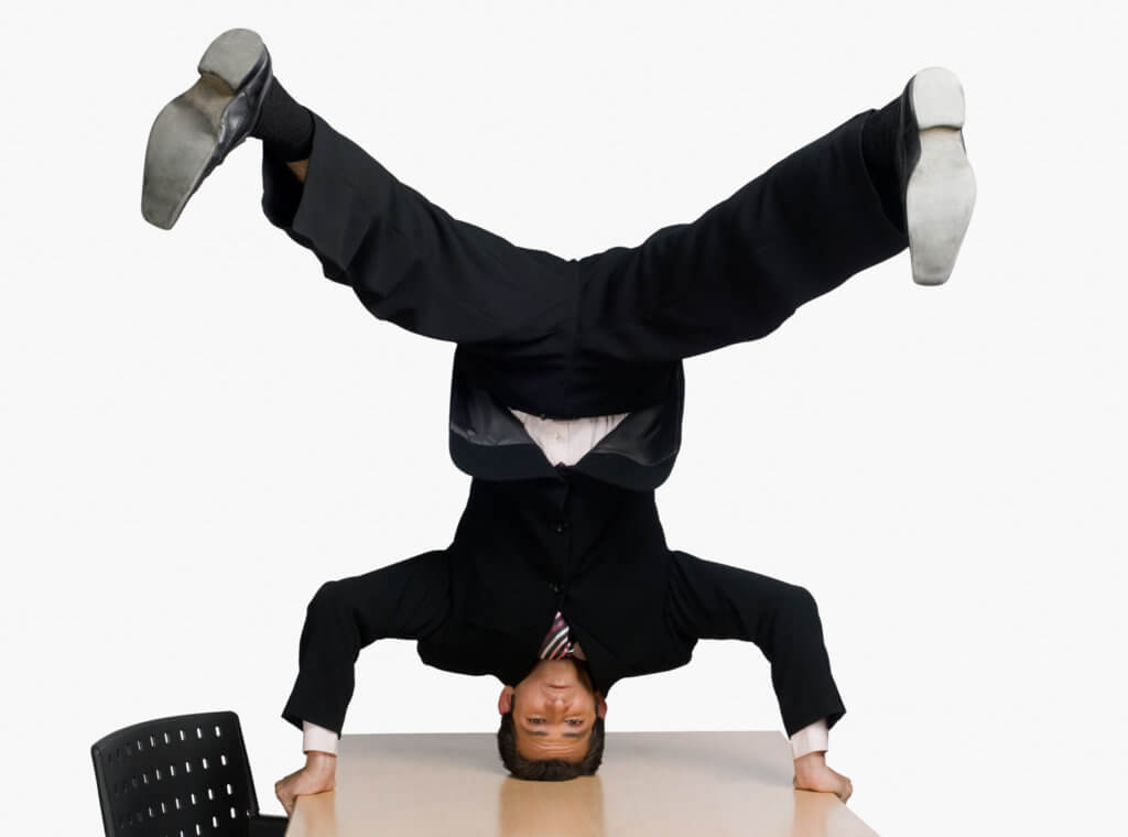 An image of a man standing on his office desk is an example of how to add relevant and attention-getting images to your website