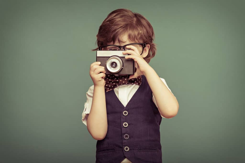 school photographer child with camera